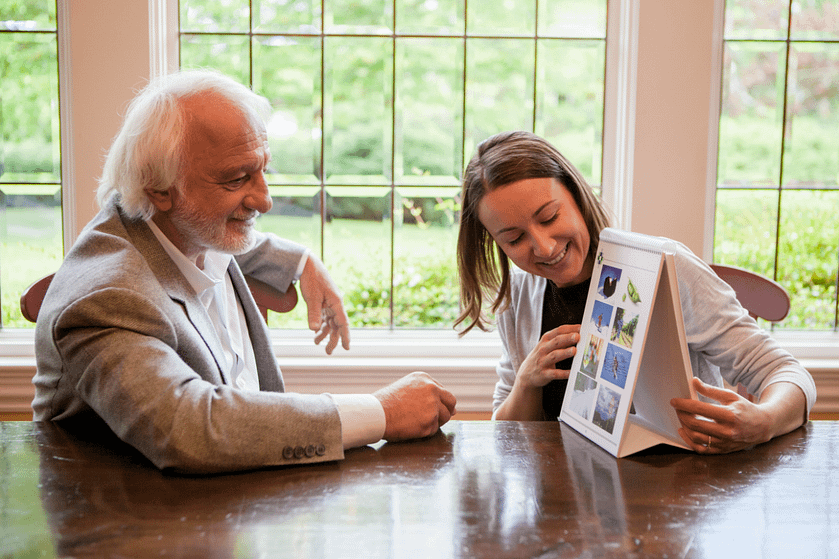 Older man playing a matching game with a senior home care specialist in Burlington, VT