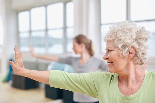 Positive Senior doing Yoga in Burlington, VT