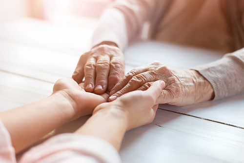 Holding Hands of a Senior Loved One