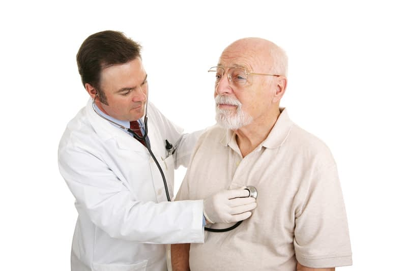 Elderly man getting his heart checked out by a doctor in Burlington, VT